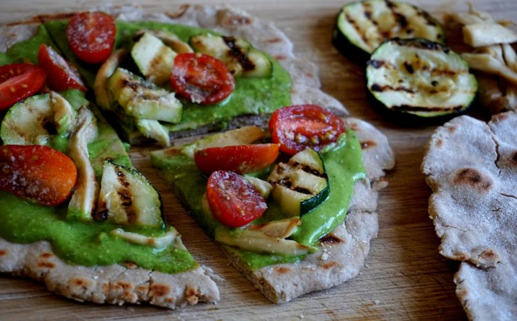 Quick pizza with gluten-free flat bread and pesto sauce