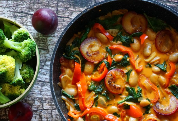 Do you want some protein with an exotic flavor? Try gigante beans with coconut red curry and plums
